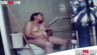 Hidden cam catches my kinky fat wife masturbating in toilet.