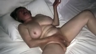 Hidden cam caught -  Wife watching porn and masturbating to hotel porn
