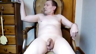 Sitting down on a chair in my briefs and spreading my legs to show off my cock
