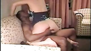 Horny milf enjoying a large dark knob whilst hubby films her