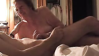 Mom sucks son with passion while the dude rubbing her clit and pussy