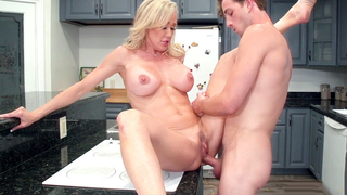 Big tits mom got pounded with her son on the kitchen stove