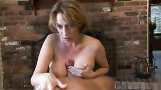 Sweet busty mother jerking off her son