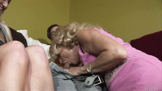 Two blonde women mom and daughter are on the sofa, sucking dick and licking it to
