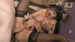 A sexy mom as pornstar with large tits is getting a dick shoved in her mouth