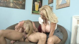 Two blonde women mom and daughter are sucking dick in a very seductive way