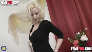 Mature mom in red satin fucks both her holes and plays with her pierced nipples