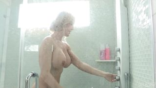 Busty blonde mom takes a warm shower! Shaving her legs and pussy while taking a nice