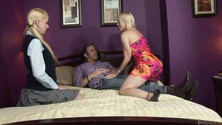 Two blondes mother and daughter are on the bed, performing in a hot threesome
