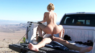 Licking the tip of his cock a truck stop and stroking it to get his cum in her mouth