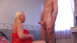 Horny mom watches son jerk off and she simply loves the view