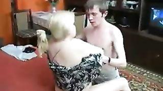 Mom jerks son as she enjoys giving him masturbation lessons until cumshot