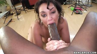 Voluptuous redhead with a huge rack takes his cock deep inside her mouth