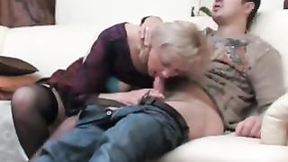 Mom swallows cum as she pulls out a massive black rod out of her throat