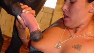 Animal sex addicted milf with big tits enjoys a huge cock of a horse in her hot mouth