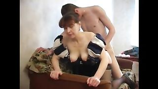 Mom gives son a blowjob going deep on his cock and dribbling on his balls