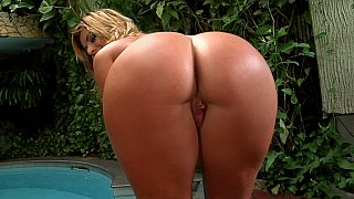 Voluptuous blonde shows off her hairy, meaty pussy outdoors