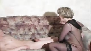 Plump mom in black stockings grinds on son's cock in real mom and son incest porn