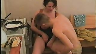 Son bangs his mature mom in the kitchen in a real mom and son incest movie