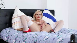 Babe in stockings oils her lovely ass up and pounds it with her toys