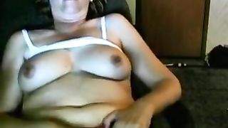 Slutty mom squeezes her big tits and makes her son watch it in a wild and real incest video