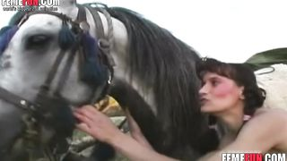Naughty woman goes for a giant cock of her horse and smacks it insanely in order to swallow cum