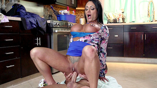 Tattooed stepmom with fake silicon tits grinds on stepson's dick on the floor