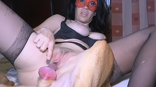 Horny brunette in mask provokes lazy dog to fuck her in XXX video