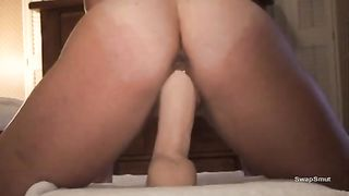 Sexy slutty wife sitting on a large sex tool during the time that her husband's filming
