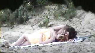 Voyeur camera capturing pair on beach having sex in public