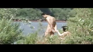 Sex in public on the edge of a lake recorded by secret voyeur livecam