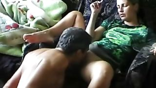 Multiple orgasms for white wife watching tv on the sofa with hubby licking