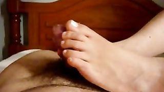 Just me play with my toes on his hard lubed up member