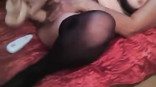 My dirty slut wife enjoys drilling her love tunnel with 2 dildos at a time